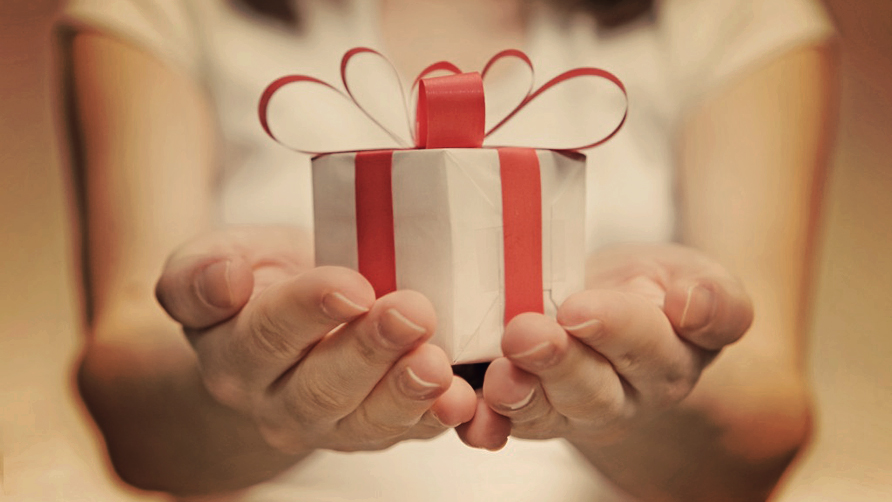 close-up-photo-of-female-hands-holding-a-gift.jpg